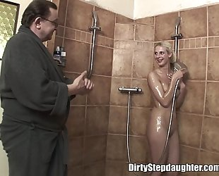 Lucky daddy bonks golden-haired stepdaughter in the shower