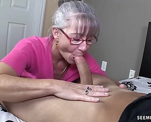 Horny granny sucks a juvenile rod