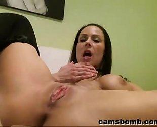 Busty hottie fucking a sextoy on webcam