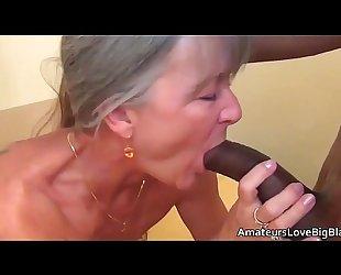 Grey haired granny enjoys large dark penis