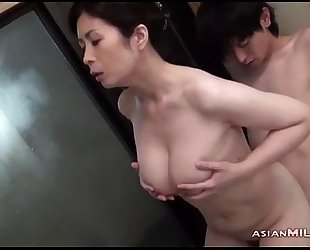Busty milf engulfing youthful stud getting her shaggy vagina fingered in the bathtube