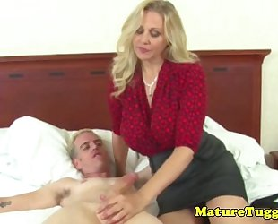 Busty cougar jerking ramrod and acquires creamed on