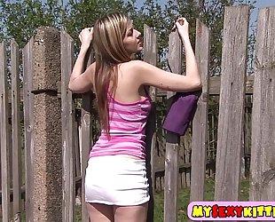 Sweet teenie gratifying herself outdoors