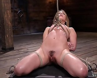 Gagged blond in servitude feet tormented