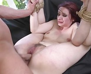 Redhead sub getting spanked, throat fucked and sodomized