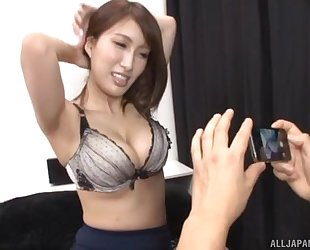 Busty Asian chick teases boyfriend with her juicy melons