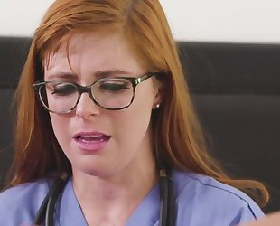 Lesbian doctor with glasses fist her patient's asshole
