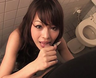 Easygoing Asian MILF gives head in public toilet