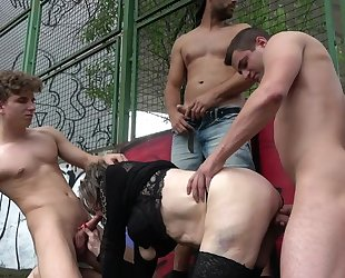 Cock-loving mature gets gang banged in public place