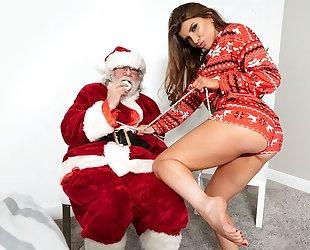 Rebellious porn star fucks her lover in front of Santa