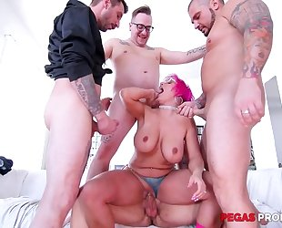 Pink-haired mature with glasses serves four hard dicks at once