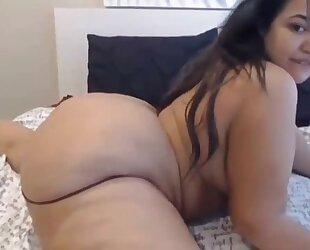 Fat ass latina masturbates in front of the camera