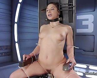 Brunette in slavery fucking machine